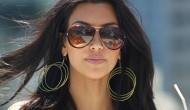 Kim Kardashian – Beach and Bikini Candids – July/August 2012